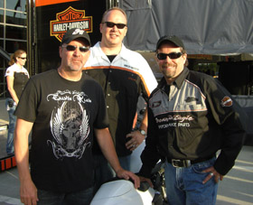 Chris Carr with owner of Harley-Davidson Motorcycles